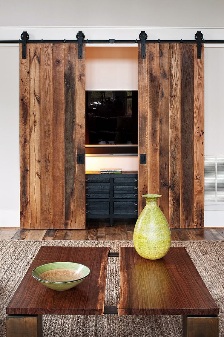 hide the living room tv behind custom sliding barn doors design visible proof