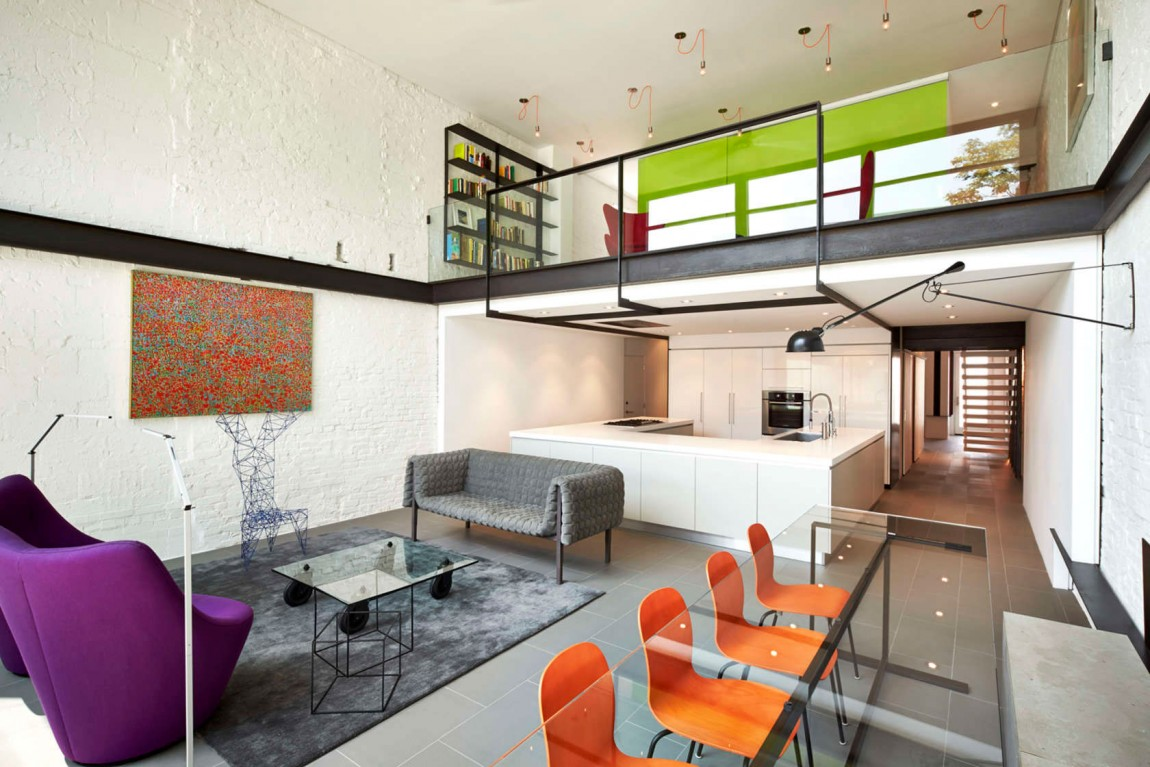Hints of orange and purple in the living space of the transformed row house