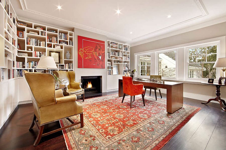 Home office and study with unique bookcase and pops of red