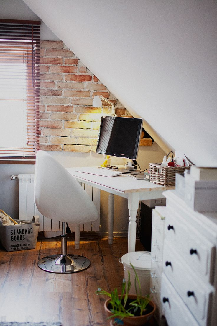 Home office nook in an attic with partial brick wall  15 Bright Attic Spaces for an Office or Studio Home office nook in an attic with brick wall exposed