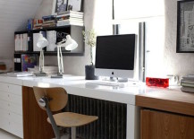 Home office with spacious desk along one wall