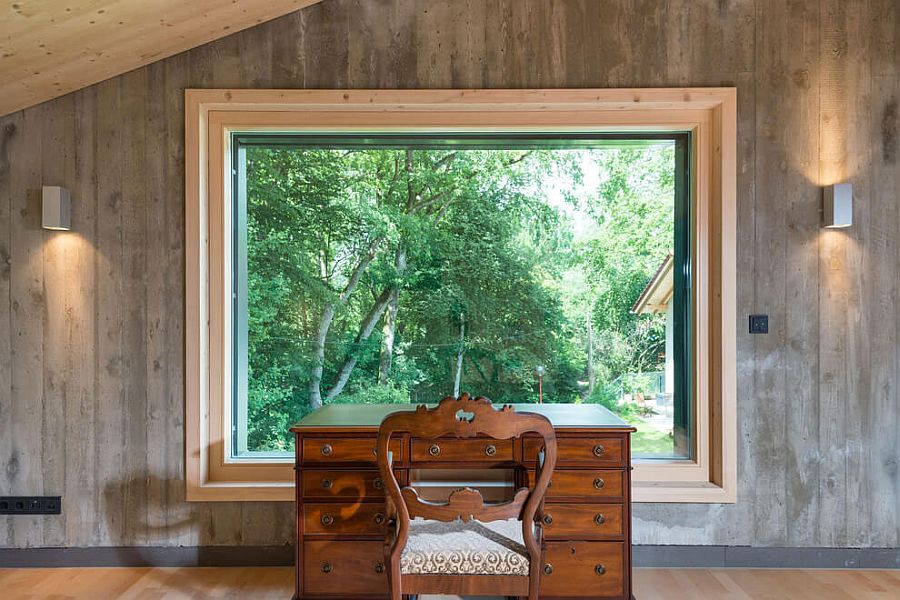 Home workspace with a classic desk and chair and a window that offers panoramic views