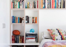 Huge-shelving-wall-until-with-space-for-the-bed-217x155