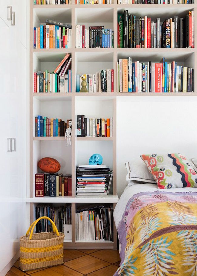 Huge shelving wall until with space for the bed