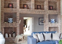 Imposing-brick-walls-and-shelves-set-the-tone-in-this-living-room-217x155