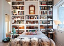 Incredible bookshelf that reaches all the way up to the high ceilings 217x155 17 Bookshelves That Double as Headboards