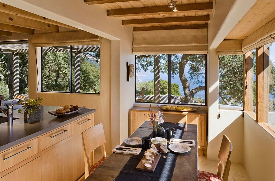 Indoor dining area of the cabin placed to make the most of scenic view outside