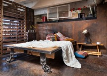 Industrial bedroom with metal flooring and walls 217x155 Metal Flooring, Dark Walls and Other Unexpected Touches