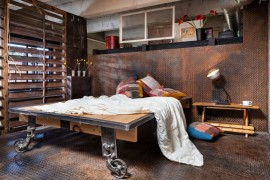 Industrial bedroom with metal flooring and walls