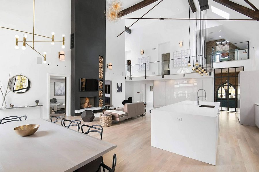 Industrial lighting fixtures and polished decor add to the eclectic vibe of the church conversion