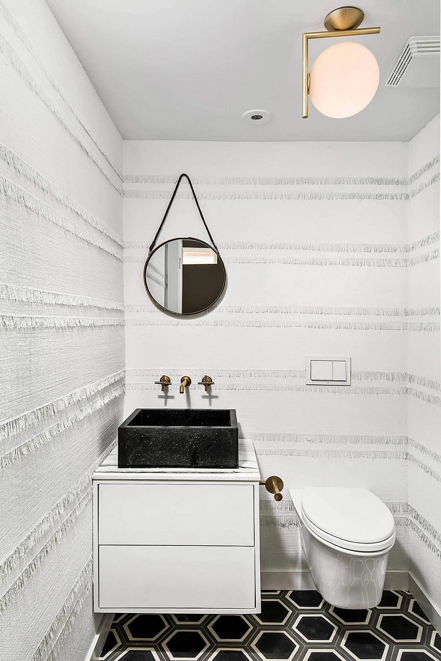 Ingenious textured wallpaper for the small powder room