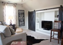 Ingenious use of barn doors to hide the living room entertainment center