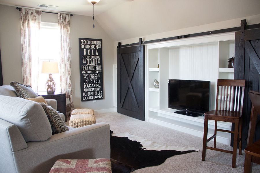 ... Ingenious use of barn doors to hide the living room entertainment  center [Design: Signature