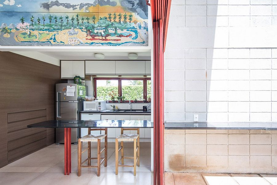 Interesting use of wall art above the kitchen nook