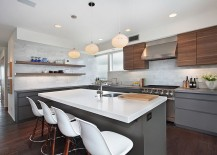 Island in gray with white worktop and overhang that serves as breakfast zone [Design: Chris Woodburn Interiors]