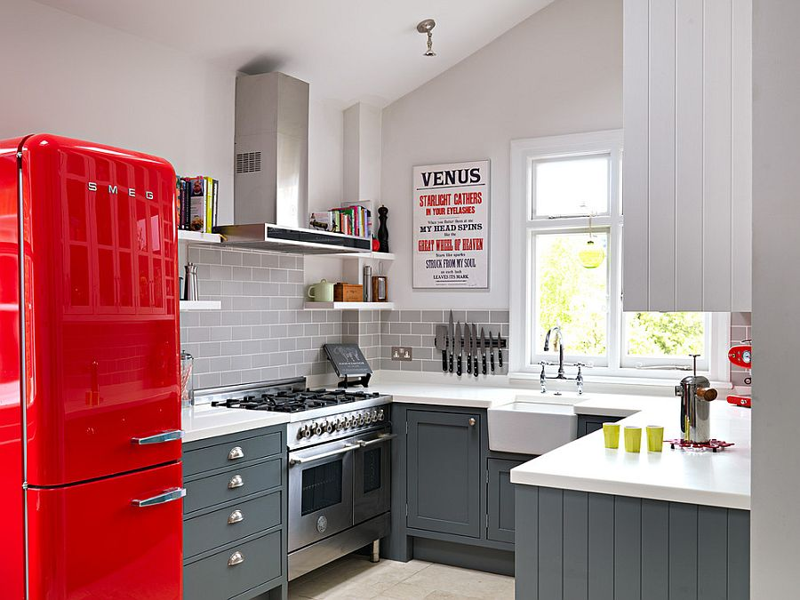 Kitchen cabinets in Mercury by Fired Earth complement the splash of red! [Design: Williams Ridout]