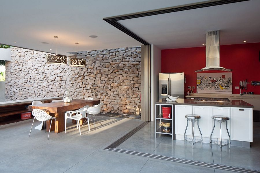 Kitchen, dining and entertaining zone of the house with a stone backdrop