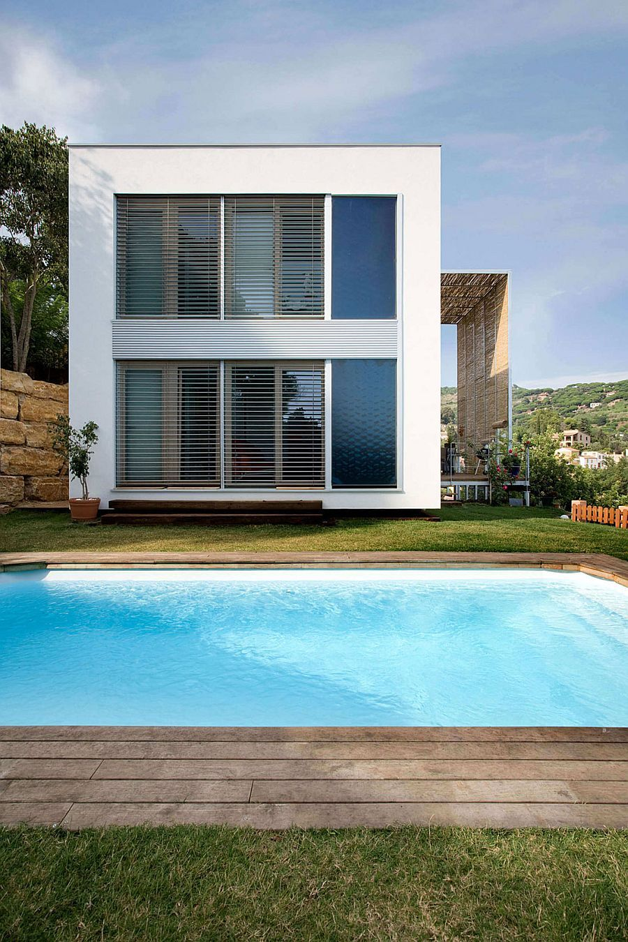 Laminated wood and glass structure Casa Saüc Solar Shading and Smart Design Shape Energy Efficient Barcelona Home