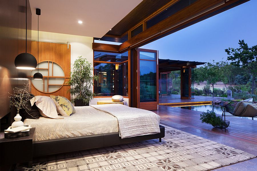 Landscape around the house becomes a part of the gorgeous Asian bedroom in Aussie home [Design: Suzanne Hunt Architect]