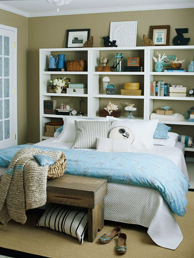 Large and wide white bookshelf with beach-themed accessories