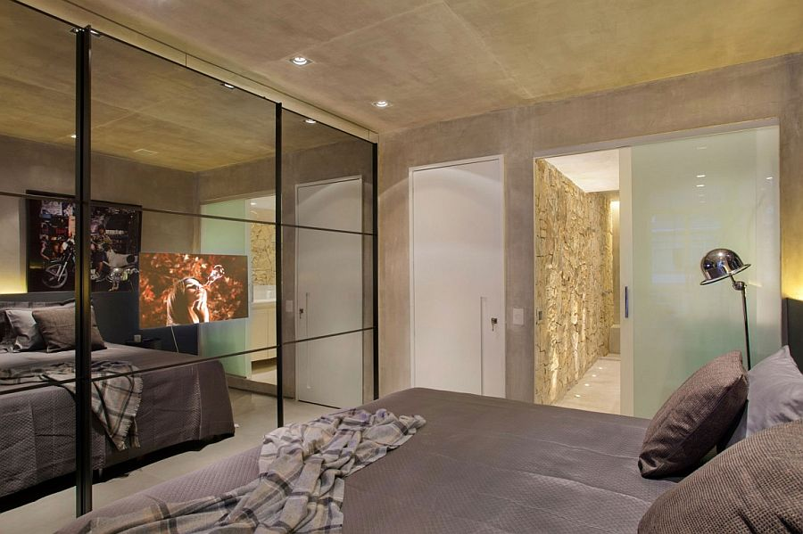 Large bedroom closet with three mirrored doors creates illusion of space