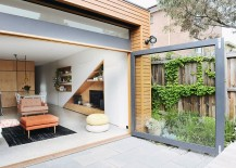 Large glass door connects the living area indoors with the rear yard 217x155 Cool Central Pod and a Cheerful Living Space Revive Dreary Melbourne Home