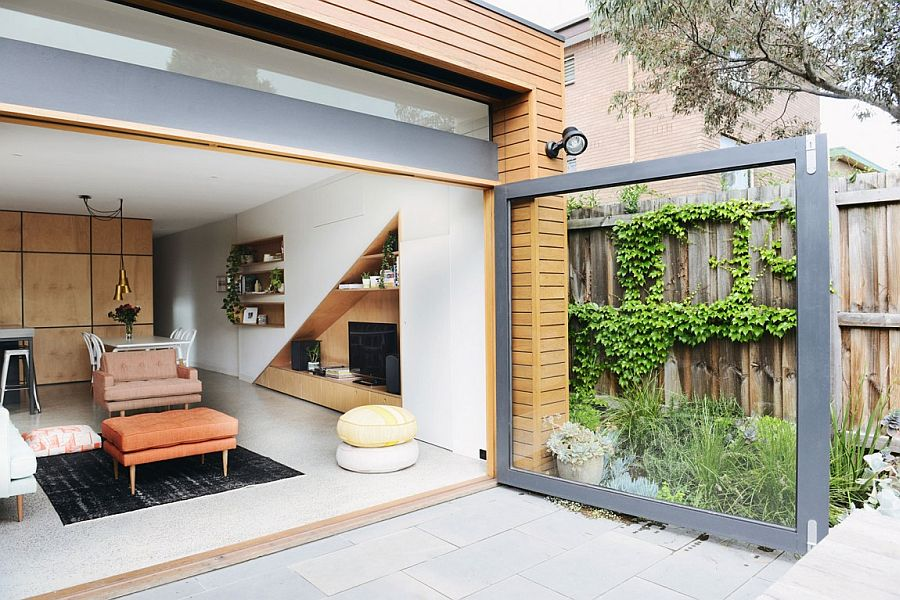 Large glass door connects the living area indoors with the rear yard