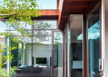 Large glass walls and doors create a beautiful indoor outdoor interplay 217x155 Vibrant Family Home in Melbourne Brings the Outdoors Inside