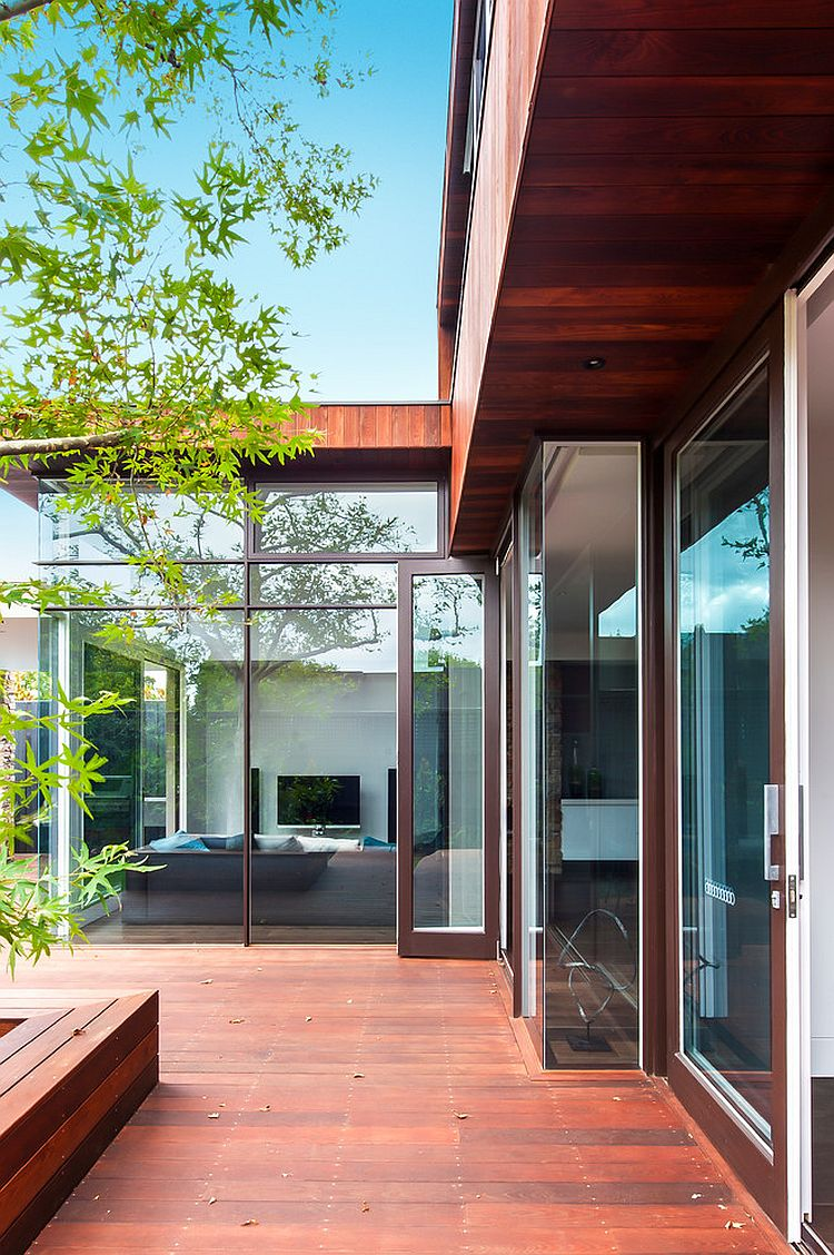 Large glass walls and doors create a beautiful indoor-outdoor interplay