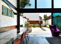 Large sliding glass doors connect the living area to the rear garden