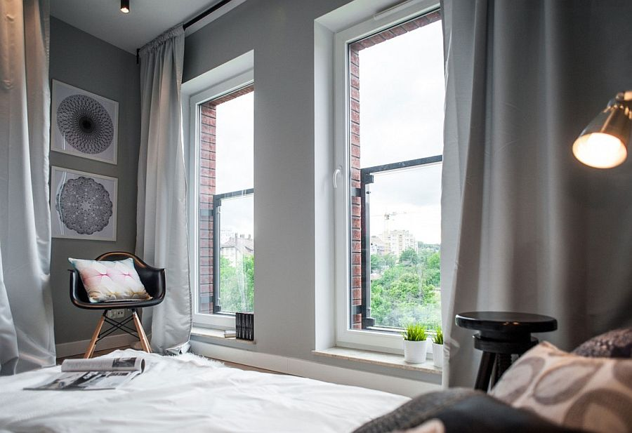 Large windows bring ample light into the small bedroom