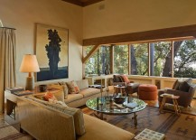 Large-windows-in-the-living-room-of-the-cabin-frame-the-lovely-view-outside-217x155