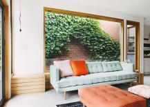 Large-wooden-bench-in-the-living-area-with-large-glass-window-that-looks-onto-the-greenery-outside-217x155