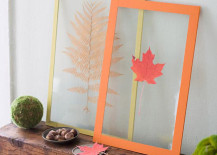Leaves pressed between clear plastic 217x155 8 Creative DIY Project Ideas for Using Fall Leaves as Seasonal Wall Art