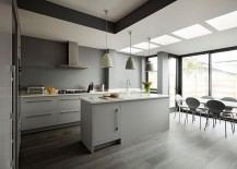 Lighting and flooring create a fusion between the various shades of gray in the kitchen