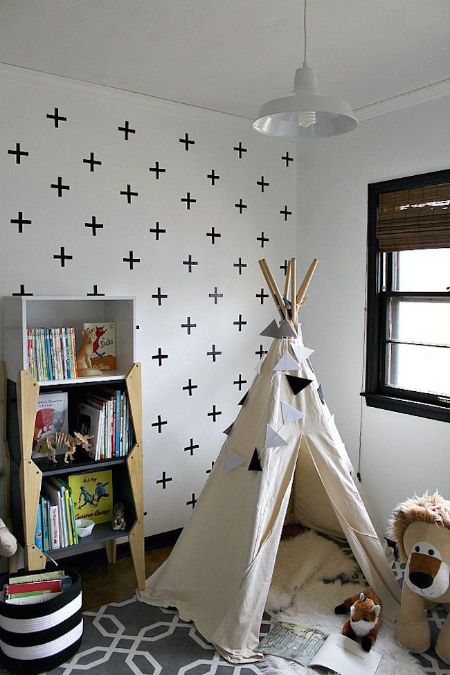 Little reading nook teepee besides a bookshelf
