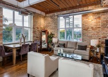 Living and dining room with exposed brick walls