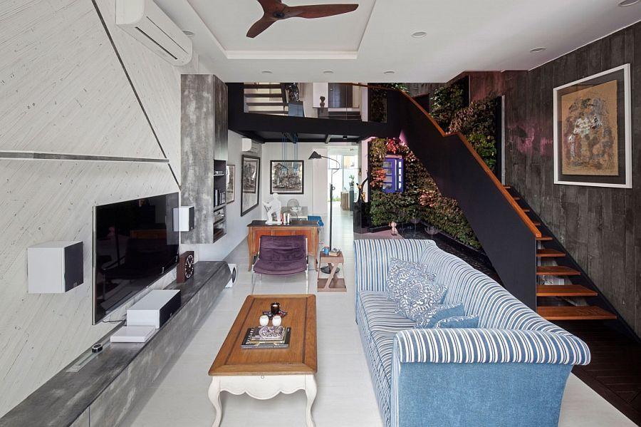 Living area combines light and dark elements to create curated chaos