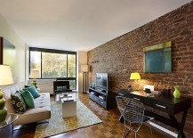 living room of new york home proudly showcases original brick wall design designed to