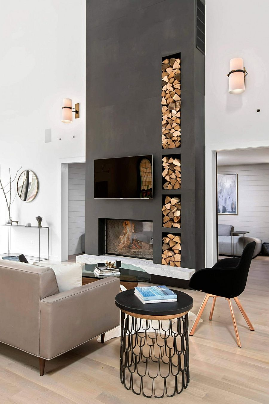 Living room of the Church conversion with gray accent fireplace wall