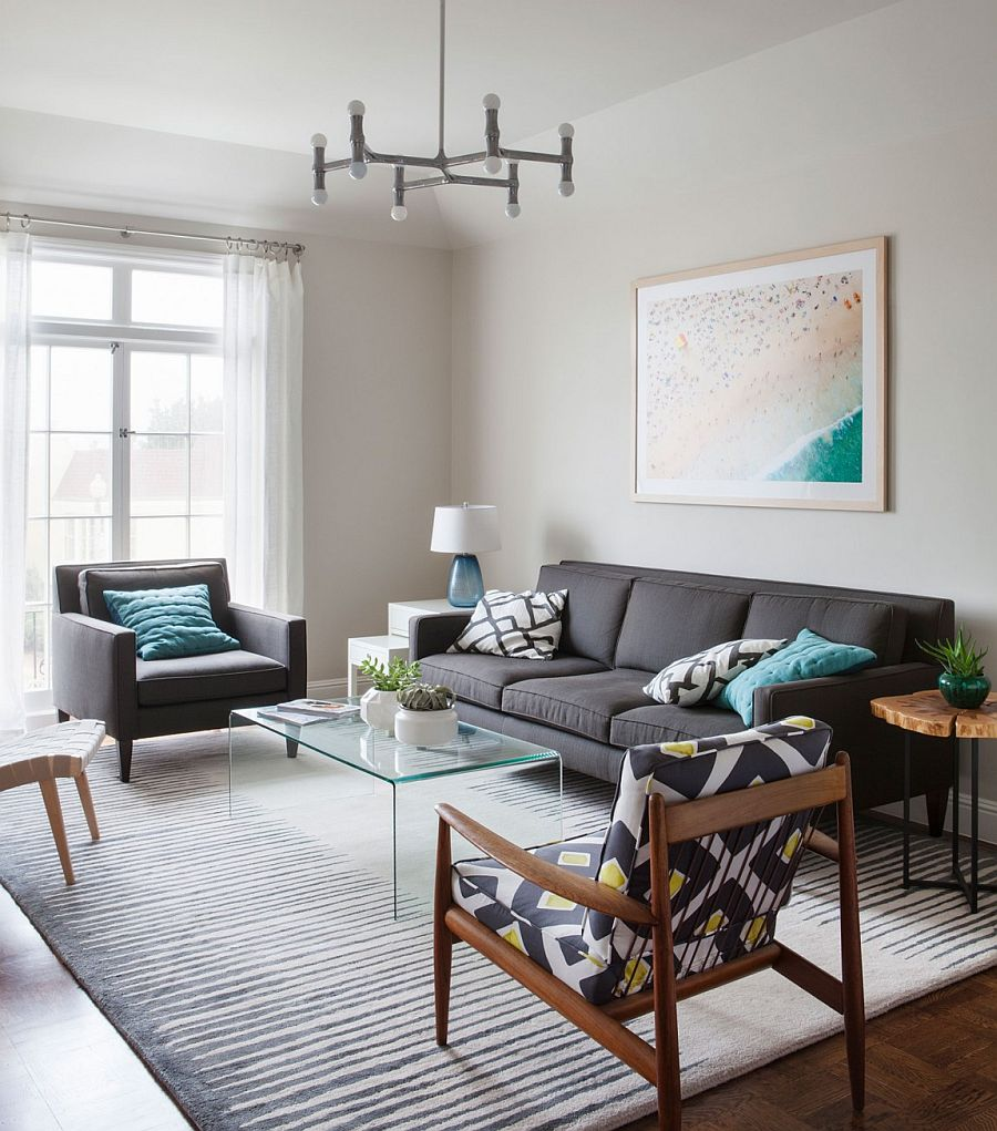Living room of the contemporary Sna Francisco home with plush couch in gray and a variety of chairs