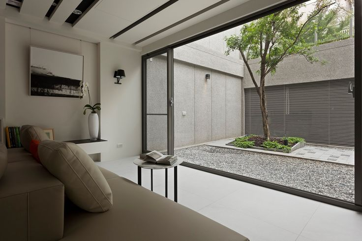 Living room that looks out into bright courtyard