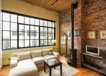 living room with freestanding fireplace large window and brick walls design crescent builds