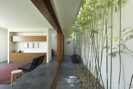 Long and linear courtyard with bamboo  16 Minimal Courtyards with Just a Hint of Nature Long and linear courtyard with bamboo