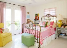 Lovely bedroom showcases the beach cottage look of shabby chic style