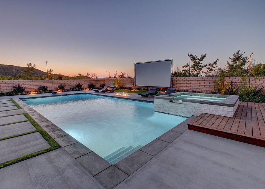 Lovely, relaxing pool area with giant screen for an outdoor movie night [Design: Aqua-Link Pools and Spas]