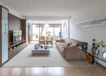 Low-ceiling-of-living-room-creates-a-cozy-intimate-atmosphere-217x155
