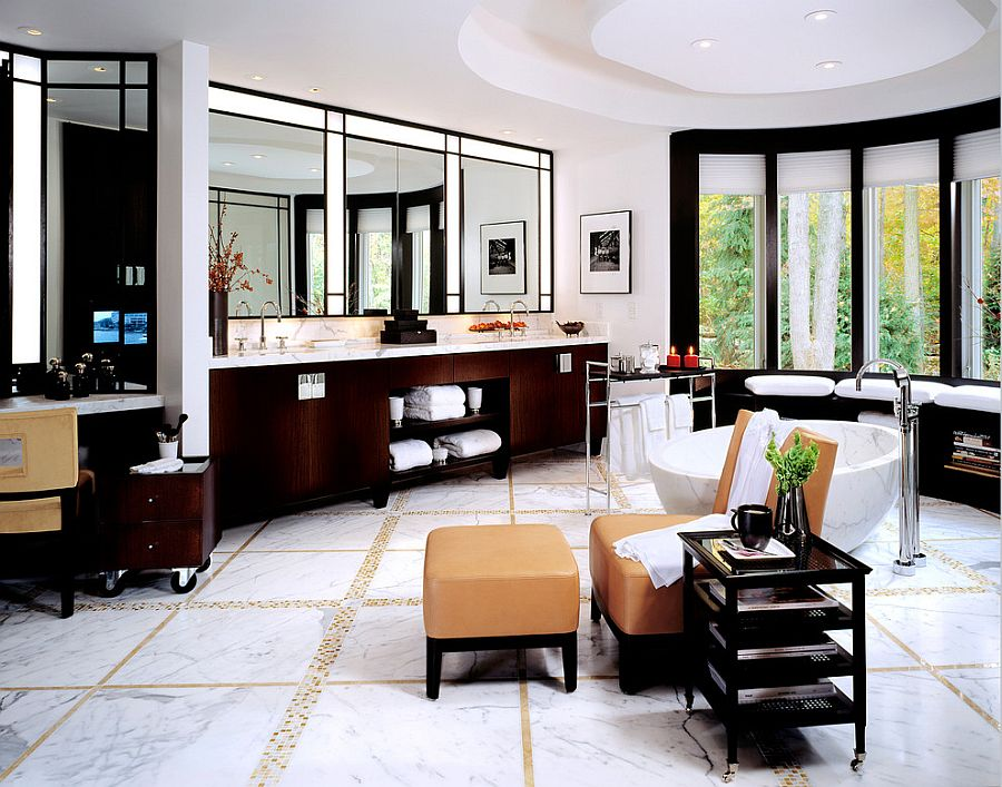 Luxurious bathroom goes the extra mile with a TV, lounge and a reading nook [Design: alene workman interior design]