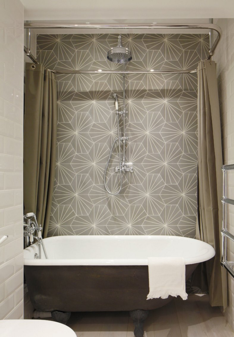 Luxury bathroom with a ceiling-mounted shower curtain rail