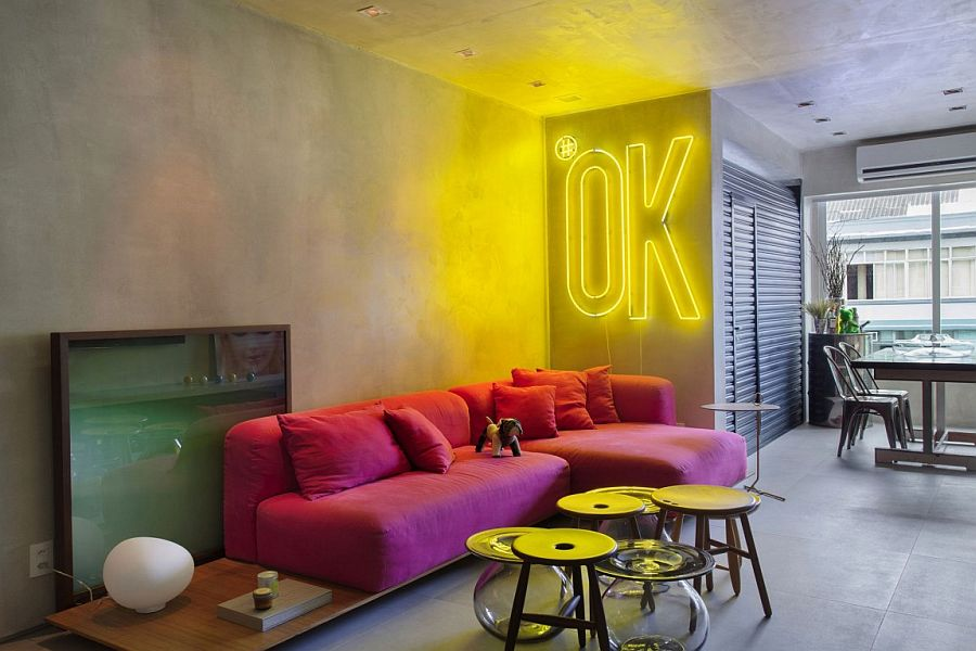 MM House in Brazil with concrete walls and illuminated wall sign